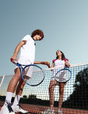 Tennis players give the ball, fair play concept. In court Royalty Free Stock Images