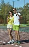 Tennis players near net Stock Photos