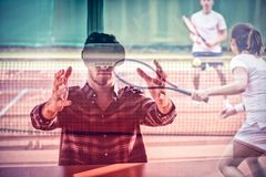 Composite 3d image of tennis players playing a match on the court royalty free stock photo