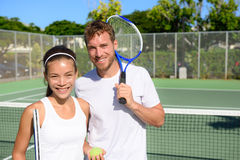 Tennis players portrait on tennis court outside. Tennis players portrait on tennis court outdoor. Couple or mixed double tennis partners after playing tennis Royalty Free Stock Photography