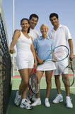 Tennis Players With Rackets And Ball On Court Stock Photography