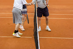 Tennis players shake hands. After the tennis match Royalty Free Stock Photo