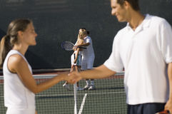 Tennis Players Shaking Hands On Court Stock Photo
