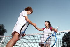 Tennis players shaking hands, fair play. Concept Royalty Free Stock Images