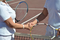 Tennis players shaking hands Stock Images