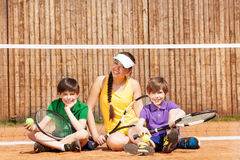 Tennis players sitting on the court after match Stock Photography