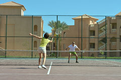 Tennis players standing near net Royalty Free Stock Photos