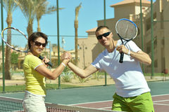 Tennis players standing near net. On court Royalty Free Stock Images