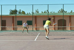 Tennis players standing near net Stock Photo