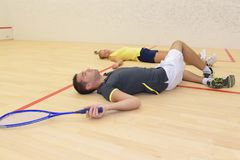 Tennis players stretching on floor. Tennis players stretching on the floor Stock Photo