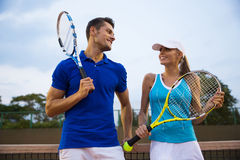 Tennis players talking at the court Royalty Free Stock Photos