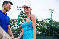 Tennis players talking outdoors Stock Image
