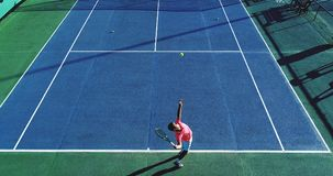 Tennis  players. Tennis players on speed surface, aerial view Royalty Free Stock Photos