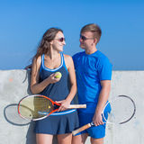 Tennis players in tennis sportswear with tennis racquets talking Stock Images