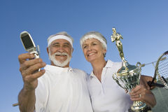 Tennis Players With Trophy Taking Self-Portrait Stock Photos