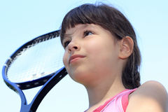 Tennis. Portrait of a young girl with a tennis racket Stock Photos
