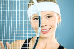 Tennis racket. Portrait of a girl tennis player holding tennis racket. Studio shot stock photography