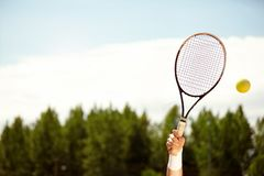 Tennis racket in air. Close up of tennis racket up in air royalty free stock image