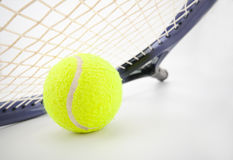Tennis racket and ball Stock Images