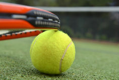Tennis racket and ball. Tennis racquet and ball on a tennis court Stock Photography