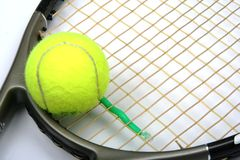 Tennis racket and ball. Tennis racket head and yellow ball Stock Photo
