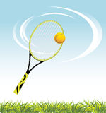Tennis racket with ball above a grass royalty free stock photos