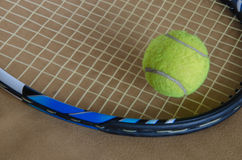 Tennis racket with ball. A tennis racket with  tennis ball on the background Stock Photography
