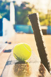 Tennis racket and ball on the bench at the  court. soft art mult Royalty Free Stock Image