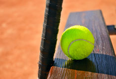 Tennis racket and ball on the bench horizontal Royalty Free Stock Photography