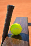 Tennis racket and ball on the bench Stock Images