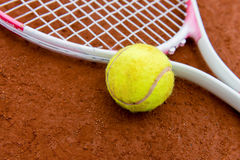 Tennis racket with a ball Royalty Free Stock Images
