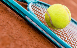 Tennis racket with a ball Stock Photography