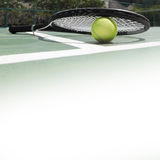 Tennis racket and ball. On the tennis court Stock Photos