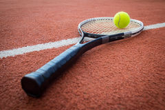 Tennis racket and ball on court Royalty Free Stock Photography