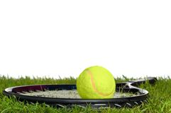 Tennis racket and ball on grass Stock Photo