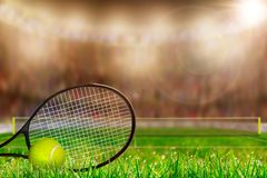 Tennis Racket and Ball on Grass Court With Copy Space. Low angle view of tennis racket and ball on grass court with deliberate shallow depth of field on brightly Stock Image
