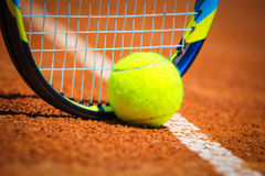Tennis racket and ball. Tennis racket and green ball Royalty Free Stock Photo