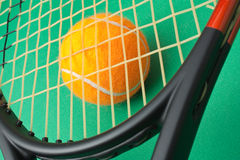 Tennis racket and  ball on green background Royalty Free Stock Photography