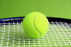 Tennis. Racket and ball on a green background Royalty Free Stock Photo