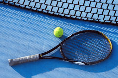 Tennis racket and ball next to net, top view Stock Images