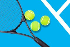 Tennis racket and ball sports on blue background. Tennis racket and ball sports on pastel blue background royalty free stock photography