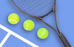 Tennis racket and ball sports on blue background. Tennis racket and ball sports on pastel blue background stock photos