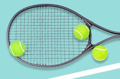 Tennis racket and ball sports on blue background. Tennis racket and ball sports on pastel blue background royalty free stock photos