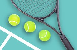 Tennis racket and ball sports on green background. Tennis racket and ball sports on pastel green background stock image