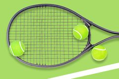 Tennis racket and ball sports on green background. Tennis racket and ball sports on pastel green background stock images