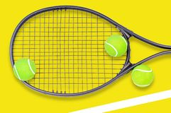 Tennis racket and ball sports on pastel background. Tennis racket and ball sports on pastel yellow background royalty free stock images