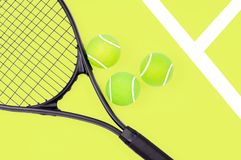 Tennis racket and ball sports on yellow background royalty free stock images