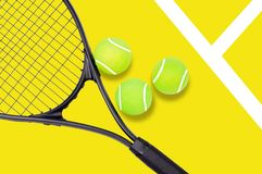 Tennis racket and ball sports on yellow background. Tennis racket and ball sports on pastel yellow background stock photography