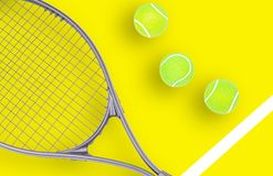 Tennis racket and ball sports on yellow background. Tennis racket and ball sports on pastel yellow background royalty free stock photography