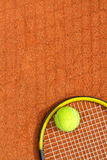 Tennis racket and ball. Vertical image. Royalty Free Stock Photography